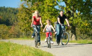 Family on bikes @ istock kzenon